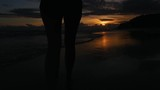 Young woman walking on the beach - Slow Motion