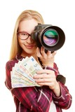 Successful woman with money and camera
