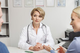 Attentive female medical adviser in office