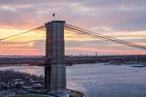Colorful sunset behind Brooklyn Bridge, Manhattan New York City
