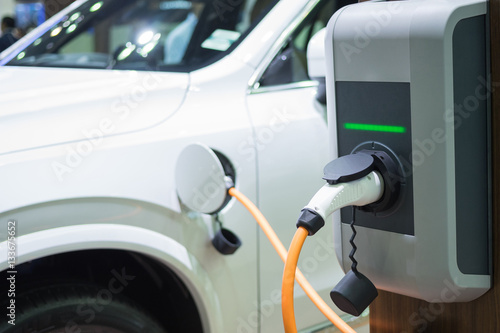 Poster Charging an electric car with the power cable supply