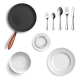 Set of ceramic plates and utensils. Isolated on white background