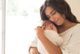 Fototapety Woman with newborn baby