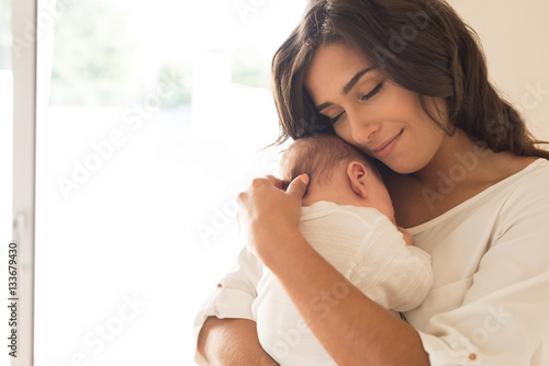 Woman with newborn baby Poster