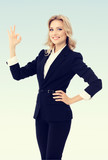 businesswoman showing okay gesture