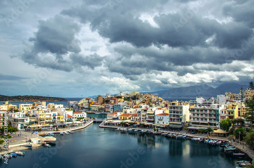 Tuinposter Algerije The lake Voulismeni in Agios Nikolaos, a picturesque coastal town with colorful buildings around the port in the eastern part of the island Crete, Greece