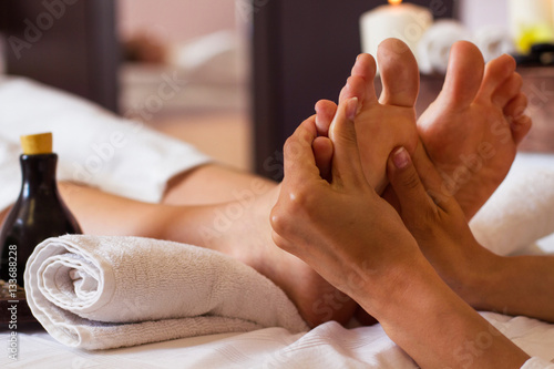 Massage of human foot in spa salon - Soft focus - 133688228