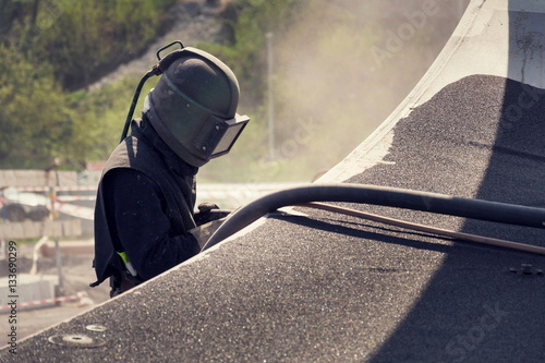 Man with helmet like robot working on a bridge construction © josefkubes