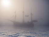 mysterious ghost ship on foggy water