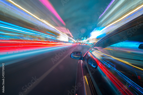 Foto op Aluminium Nacht snelweg View from Side of Car moving in a night city, Blured road with lights with car on high speed. Concept rapid rhythm of a modern city.
