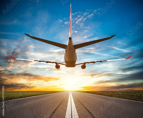 Passenger plane fly up over take-off runway