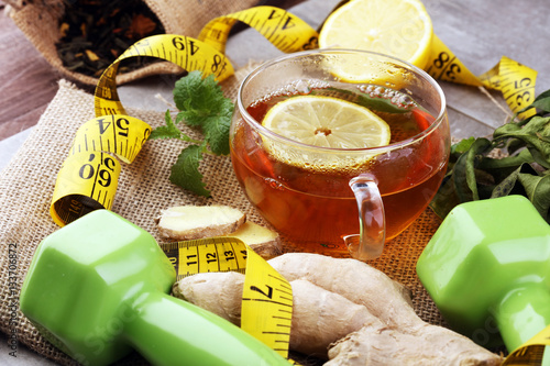 ginger tea - fitness liefestyle concept with tea, dumbells and measure tape - He Poster