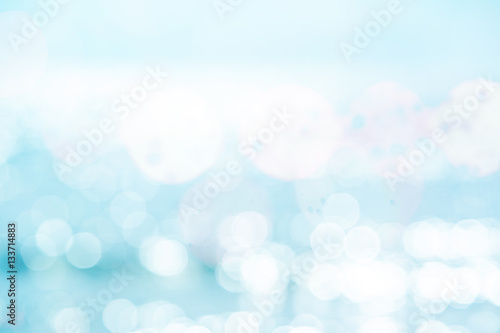 Blue water and sun reflections background - 133714883