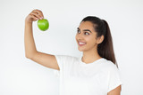 Closeup of Happy Young Indian Woman Raising Apple