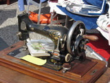 Vintage sewing machine at flea market . Tuscany, Italy