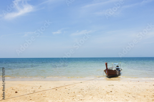 Poster Boat On Beautiful Tropical Sand Beach