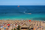 Resort Sunny Beach Bulgaria panorama of the beach in summer. Panoramic top view Sunny Beach Bulgaria. The boat and a parachute into the sea. - 133779436
