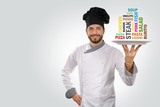 chef holds a plate with different food names. copy space