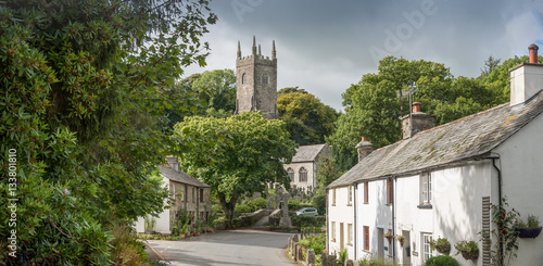 Street view with an old cottage and the church in the picturesque village Altarnun in north Cornwall Poster