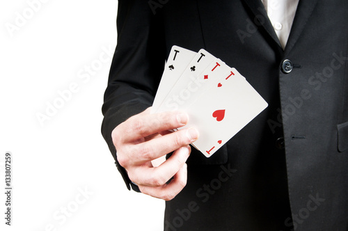 Poster Man's hand holding a trump, the four aces