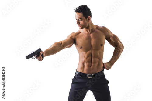 Half Body Shot Of A Handsome Athletic Man With No Shirt Holding A