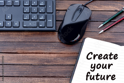 Poster The words Create your future on notebook