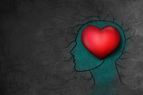 Human head with 3d Red Heart over dark Grunge Background