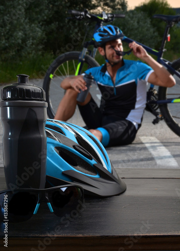 Poster helmet and sunglasses cyclist