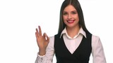 business woman doing the ok sign and winks - isolated