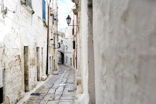 narrow alleyway in Ostuni, Apulia, Italy