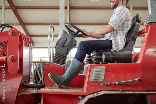 Poster man or farmer driving tractor at farm