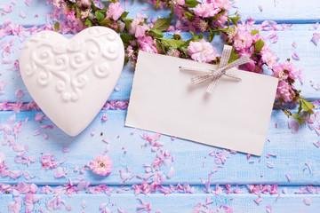 Background  with elegant sakura  flowers, white decorative heart