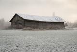 Old barn in a snowy field