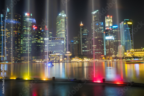 Poster Financial and business buildings at Marina Bay with music and light show on fore