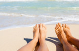 Romantic beach holiday. Couples feet on the beach.  - 133955400