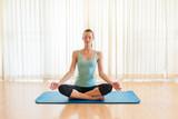 Woman meditating indoors.