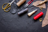 leather craft instruments on dark background top view mock up