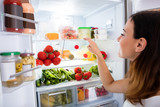 Fototapety Woman Searching For Food In The Fridge