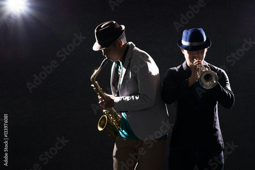 Duo musician in dark with lens flare effect Poster