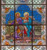 VIENNA, AUSTRIA - DECEMBER 19, 2016: The Flight to Egypt scene on the stained glass of church St. Laurenz (Schottenfelder Kirche) by prof. Rudolf Geyling (1897) in workroom Carl Geylings Erben.