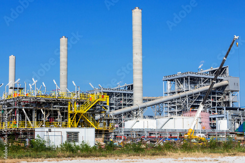 Staande foto Industrial geb. Refinery tower in petrochemical industrial plant with cloudy sky
