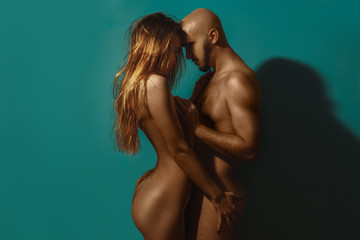 young girl and Guy stand naked facing each other