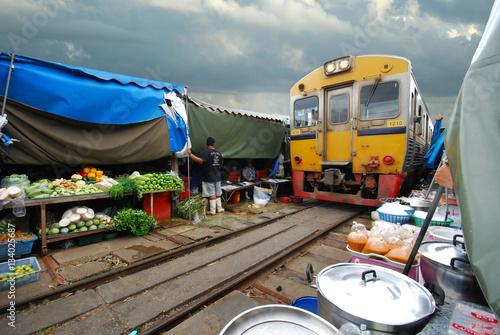 Foto op Plexiglas Indonesië Fresh market on the railroad track, Mae Klong train station, Thailand