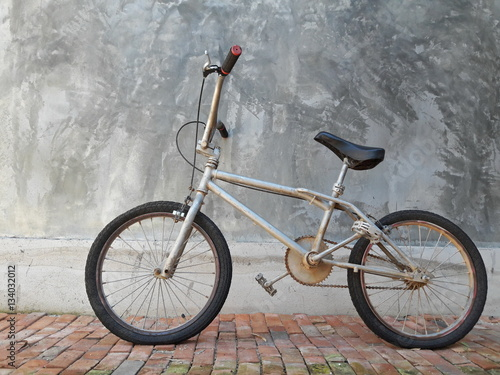 Poster One Bike,Bicycle vintage style, Concrete wall,ฺBMX Bike.