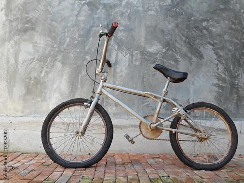 Poster One Bike,Bicycle vintage style, Concrete wall,ฺBMX Bike.