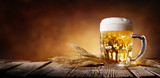 Beer With Wheat On Wooden Table  - 134042264