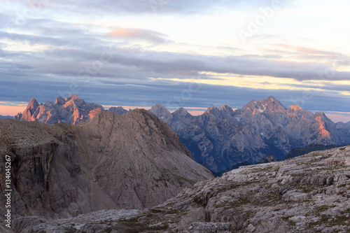 Sexten Dolomites mountains panorama with Alpenglow at sunrise in South Tyrol, It плакат
