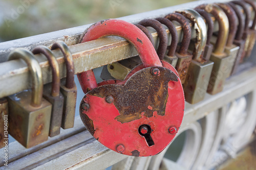 Foto op Canvas Kiev Red heart-shaped lock are hanging on the bridge lovers