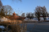 view of the nature near the lake in city Park in winter