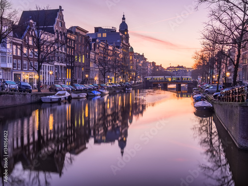 Amsterdam canal and bridge in the morning Poster